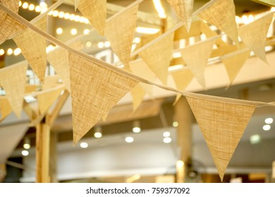Triangular flags of decorated celebrate outdoor party. Vintage bunting flag.