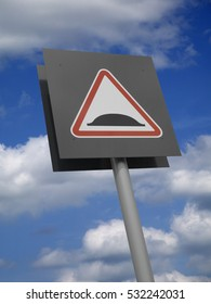 TRIANGULAR RED ROAD TRAFFIC SPEED BUMP SIGN ON GREY BACKGROUND WITH BLUE SKY