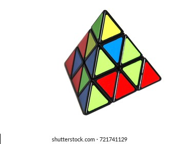 Triangular rubik`s cube Rubik`s cube in a shape of a pyramid isolated on white background
