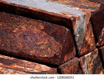 Triangular rusted Inglots of a heavy metal