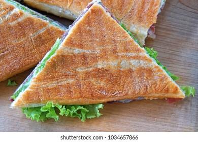 Triangular toast sandwiches diagonally cut