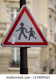 Triangular warning sign to announce the presence of a school