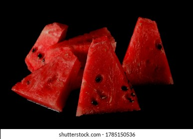 Triangular watermelon slices isolated on black background
