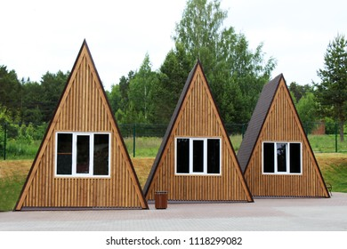 Triangular wooden houses for rest, outdoor objects