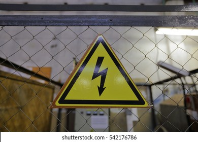 The triangular yellow sign of the danger of electric shock