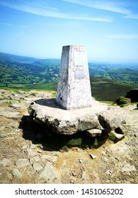 Triangulation Point landmark on the summit of Sugar Loaf Mountain - is situated 2 miles north-west of Abergavenny. It is the southernmost of the summit peaks of the Black Mountains and is 596m high.