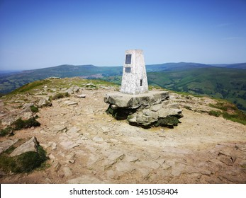 Triangulation Point on the summit of Sugar Loaf Mountain - is situated 2 miles north-west of Abergavenny. It is the southernmost of the summit peaks of the Black Mountains and is 596m high.