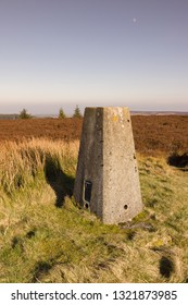 Triangulation point or pillar on the summit of Cyrn y Brain North Wales marking summits of hills and mountains and serve as navigation aids to hikers