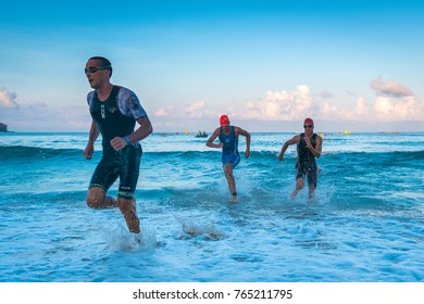 Triathletes running out of the sea after swimming in Laguna Phuket Triathlon 2017 at Laguna, Phuket Thailand, November 19, 2017