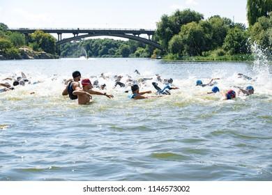 Triathlon Cup of Ukraine and Cup of Bila Tserkva. July 15, 2018 in Bila Tserkva, Ukraine. Triathlete mans swimming freestyle crawl