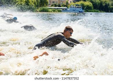 Triathlon Cup of Ukraine and Cup of Bila Tserkva. July 15, 2018 in Bila Tserkva, Ukraine.Triathlete running at swimstart