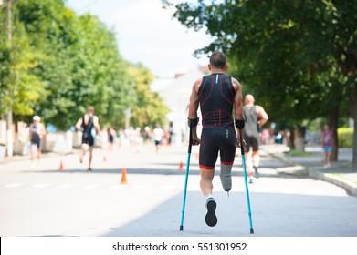 Triathlon Cup of Ukraine and Cup of Bila Tserkva. July 24, 2016 in Bila Tserkva, Ukraine. Back view of disabled paralympic athlete.
