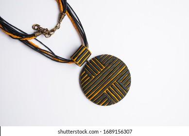 Tribal geometric pendant isolated. Handmade minimalist jewelry.