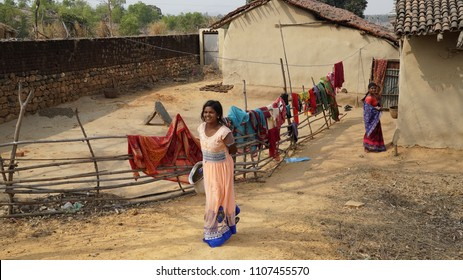 tribal girl coming out of her mud house Daldali Village Rural India Dhanbad / Jharkhand state of India / at Jharkhand / India clicked on 10 February 2018