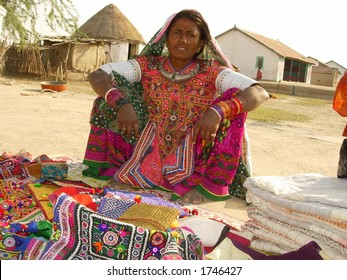 a tribal indian woman selling handicraft products