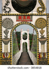 Tribal Suspension Bridge -- located in Taiwan; the writing shows the name of bridge in Chinese and tribal language