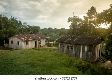 Tribal village at sunset in the Amazon rainforest in Peru