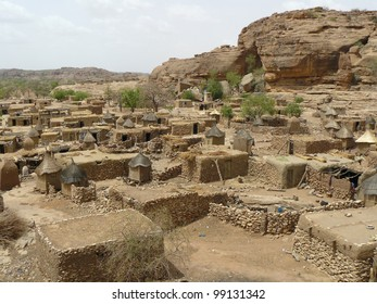 Tribal village in the West African nation of Mali. Village consists of flat-roofed dwellings and granaries with thatched roofs.