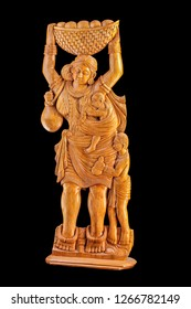 Tribal Woman with  native jewllery and costume  carrying basket  on head with her children represented in lacquered wood carvings  from Bastar, Chhattisgarh, India.Asia