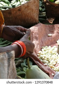 Tribal woman selling beans and other vegetables  in Orissa, India