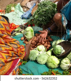 Tribal woman sells vegetables  in weekly market  on Nov 12, 2009 in Ankadeli, Orissa in India