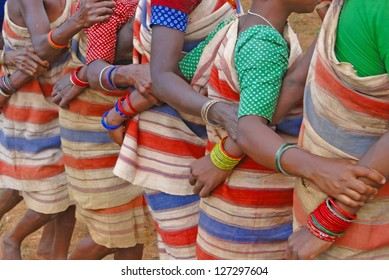 Tribal women link arms for 	Gdaba harvest dance  in Lamptaput, Orissa, India