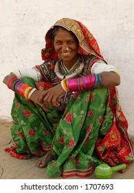 a tribal women posing in a village in india
