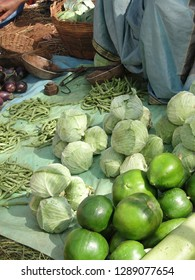 Tribal women sell fresh cabbage and other vegetables  in Orissa, India
