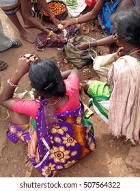 Tribal women sell vegetables  in weekly market  on Nov 12, 2009 in Ankadeli, Orissa in India