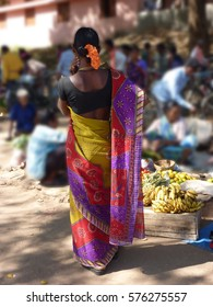 Tribal women sell vegetables  in weekly market  on Nov 1, 2009 in  Orissa in India
