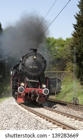 """TRIBERG, GERMANY - JUNE 13: The steam strain """"Schwarzwaldbahn"""" near Triberg on June 13, 2011. The annual ride on the historic steam train is a major black forest tourist attraction."""