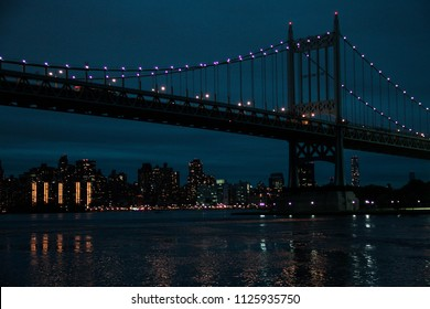 Triborough bridge and Manhattan at vintage night sky, Astoria Park, New York
