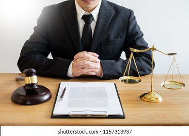 tribunal Attorney lawyer working with documents and wooden gavel on tabel in courtroom. justice advice and law judge legislation concept
