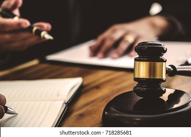 tribunal and justice concept, Consultation with insurance lawyer and customer with dark color tone