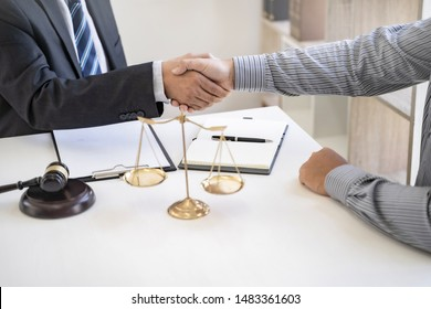 tribunal justice lawyer hands shaking with client in courtroom.