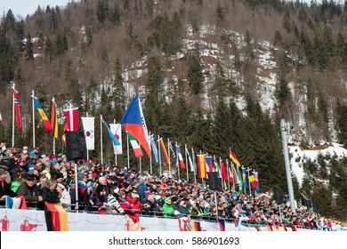 Tribune with fans and flags on Staidum, IBU World Championship Biathlon 2017, Hochfilzen, Austria, February 12th 2017, Editorial photo
