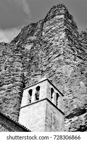 tribute to Ansel Adams, church of Riglos town, series of black and white artistic photographs of landscapes of The mallos of Riglos, Vertical mountains for climbers in Huesca, Aragon, Spain,