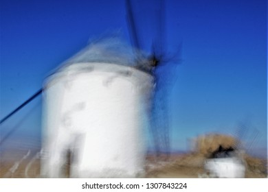 Tribute to Ernst Hass, Tribute to Monet, photographic sweeps at low shutter sweep of windmills in Consuegra, Toledo, Spain, impressionist photograph of the people, sweeps of unrecognizable figures,