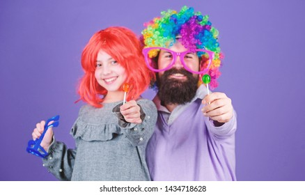 Tribute to fun dad. Easy simple ways be fun playful parent. How crazy is your father. Man bearded father and girl wear colorful wig while eat lollipop candy. Thing loving father do for children.