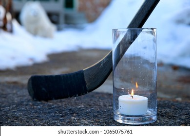 A tribute with a hockey stick and candle for the players who died in the Humboldt Broncos junior hockey team's bus accident.