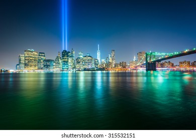 The Tribute in Light over the Manhattan Skyline at night, seen from Brooklyn Bridge Park, in Brooklyn, New York.