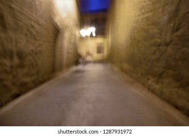Tribute to Monet, tribute to Ernst Hass, impressionist photograph narrow streets at night, Toledo, Spain, photographic sweeps at low shutter speed, blurred background, motion sensation,