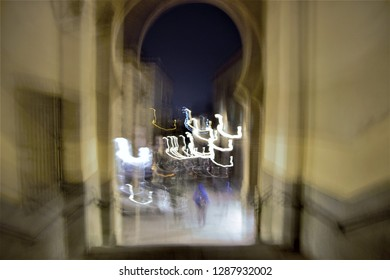Tribute to Monet, tribute to Ernst Hass, impressionist photograph of  arch of blood, at night, Toledo, Spain, photographic sweeps at low shutter speed, blurred background, motion sensation,