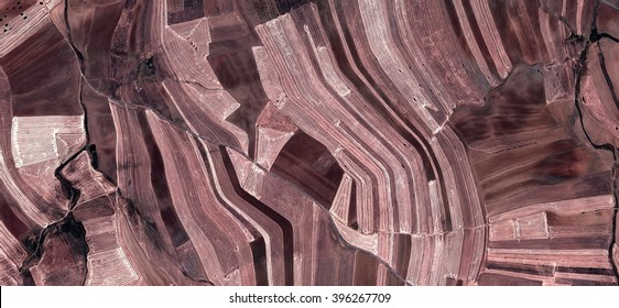 Tribute to Picasso, abstract photography of the Spain fields from the air, bird's eye view, tribute to Pollock, artistic representation of human labor camps, abstract expressionism, contemporary art,