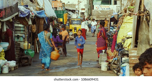 TRICHY, INDIA - JULY 15TH, 2017: Busy street scene in the slum area of India.Slum house,