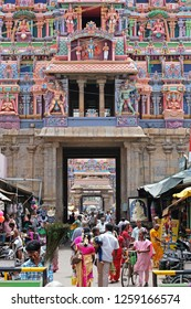 Trichy, India - March 14, 2018: Pilgrims passing through a series of colorful  gateways, or gopurams, in the Sri Ranganatha Swamy Hindu temple complex in Tamil Nadu state