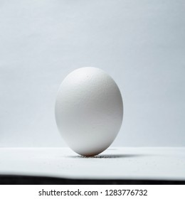 trick with an egg that stands upright on a table on grains of salt