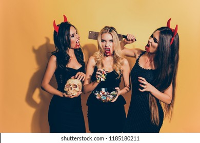 Trick or treat! Or death! Diabolic, satanic, cursed, paranormal creatures of the night. Terrifying gothic ladies with beaming white canines, cruel eyes, holding knife, gummy worms, braincase