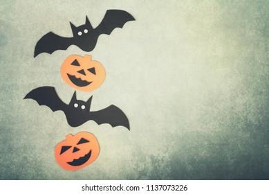 trick or treat. Halloween concept with bats and halloween pumpkin