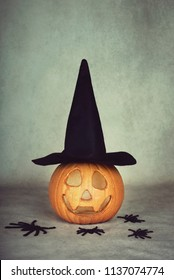 trick or treat. Scary halloween pumpkin on gray background